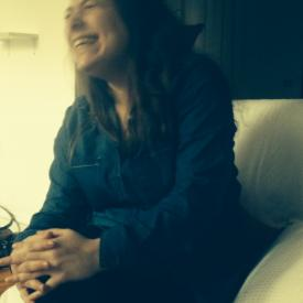 A blurry portrait of Amanda laughing