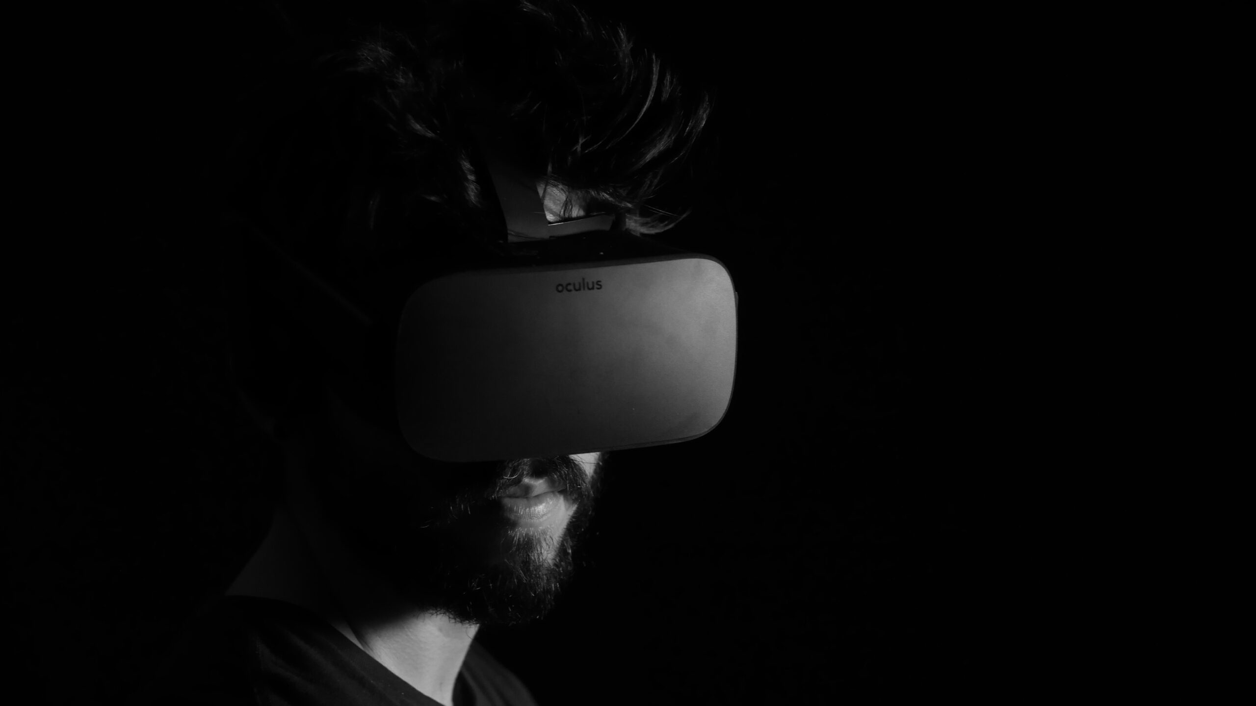 A dark photo of someone wearing VR goggles